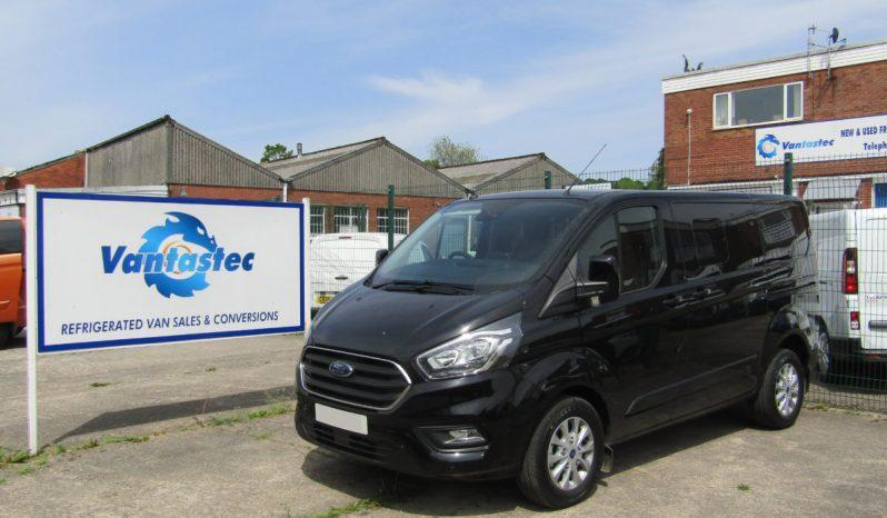 3/4 view of black Ford Transit Custom crew van