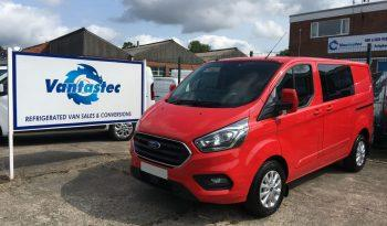 3/4 front view of red Ford Transit Custom