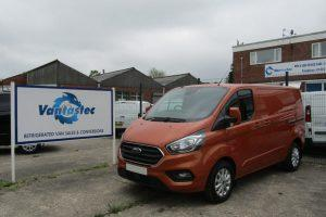 3/4 view of orange Ford Transit Custom panel van