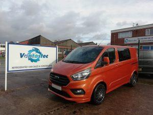 3/4 view of Vantastec's Orange Ford Transit Custom TEC+