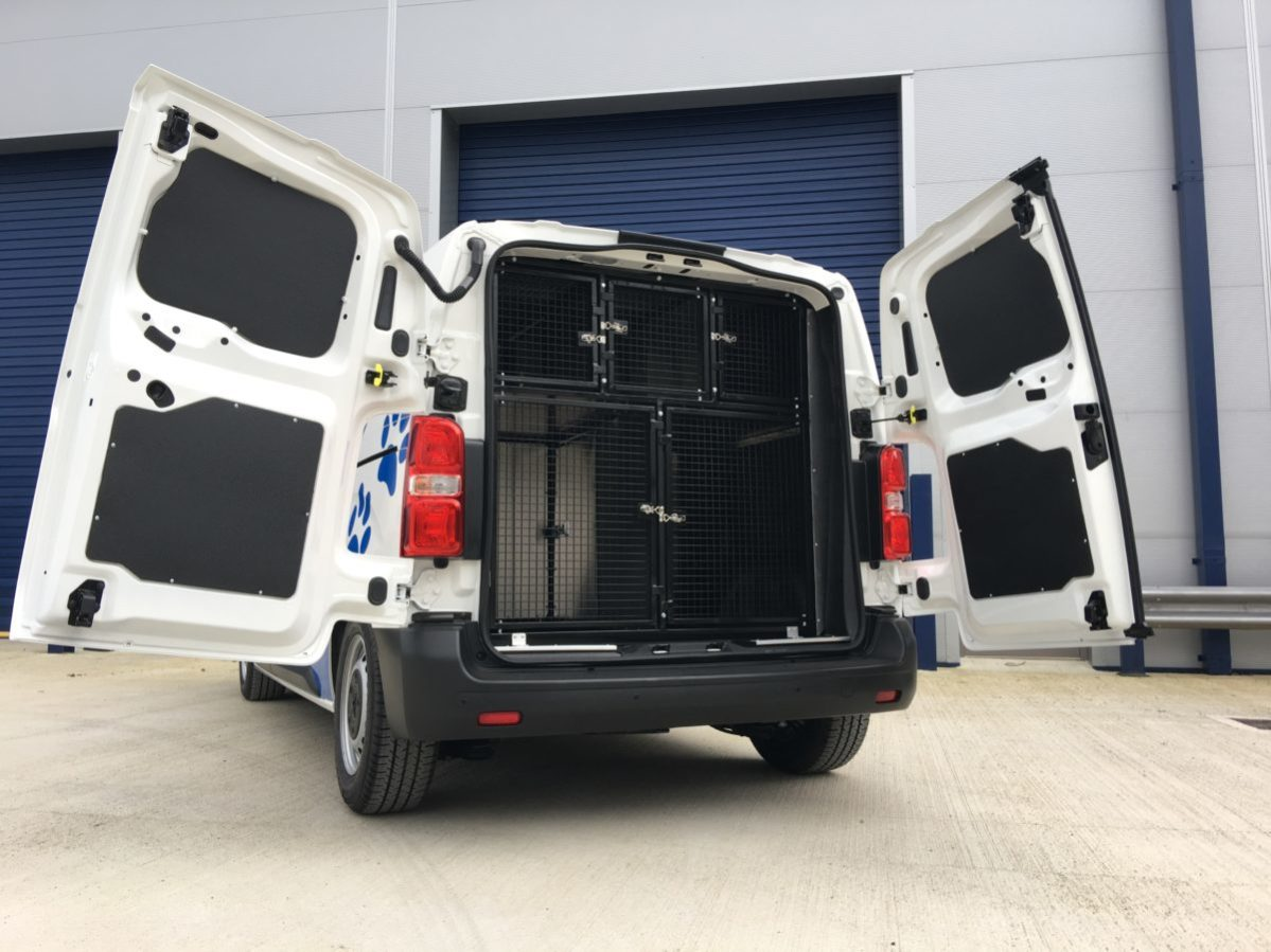 Watson Walkies dog van from rear, displaying internal cages