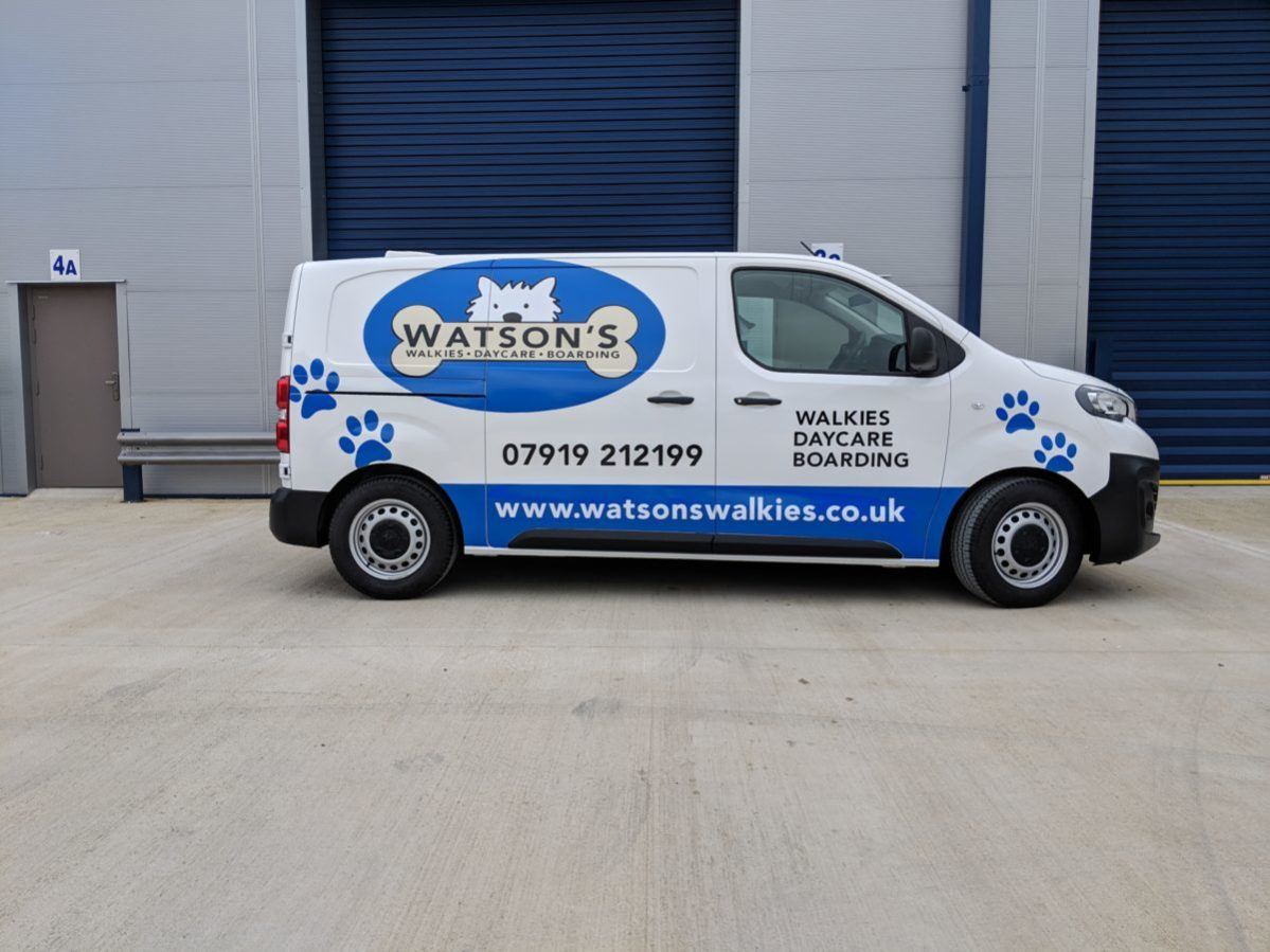 Side view of Watson's Walkies dog van