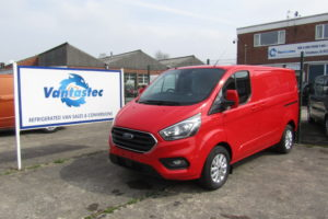 Red Ford Transit Custom panel van with rear tailgate as converted by Vantastec