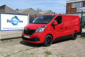 Red Renault Trafic SL27 panel van with black addition as converted by Vantastec
