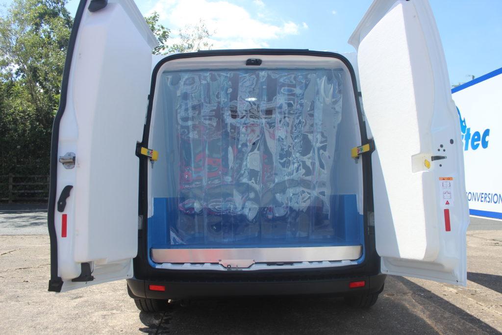 Rear curtains in a Peugeot Partner fridge van